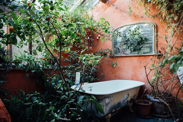 A bath situatied in the shared area of the farmhouse at Old Chapel Farm