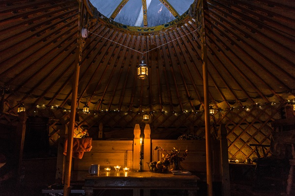 Francesca Cassini starts the fire in her Yurt near Llandinam, North Wales