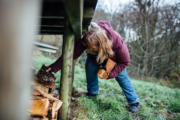 Francesca Cassini collects firewood for her yurt stove at Old Chapel Farm