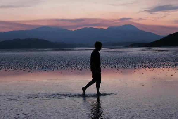 The sun sets over mud flats near Auchencairn in Dumfries and Galloway, Scotland. Photo by Lucy Purdy