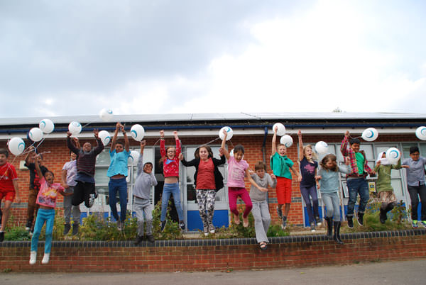 Children in Oxford celebrate the success of a community energy project. Image: Ethex