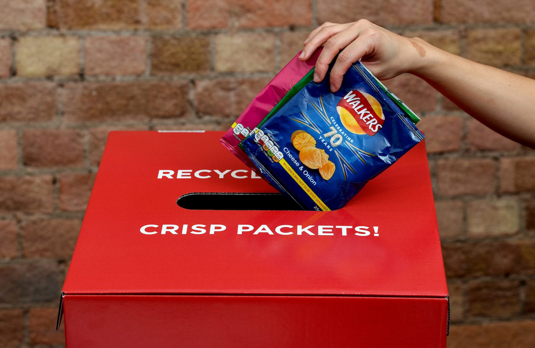 Image for Walkers to recycle crisp packets after postal protest