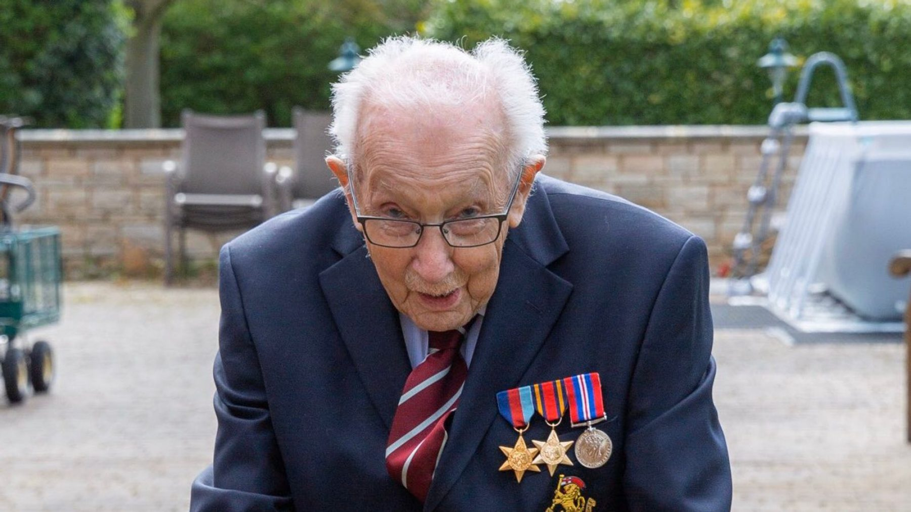 Image for Captain Tom Moore has now raised £27m for the NHS by walking laps of his garden