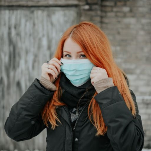 A woman with a coronavirus mask on