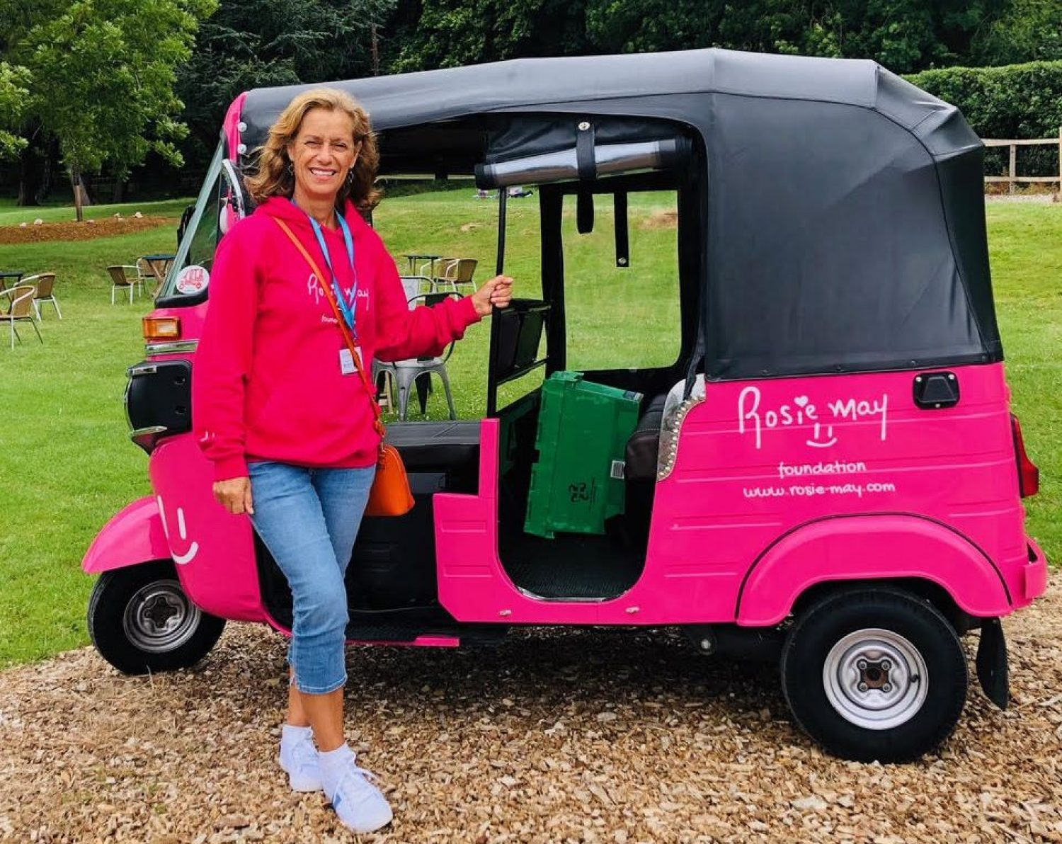 Mary Storrie pictured with her pink tuk tuk, Rosie