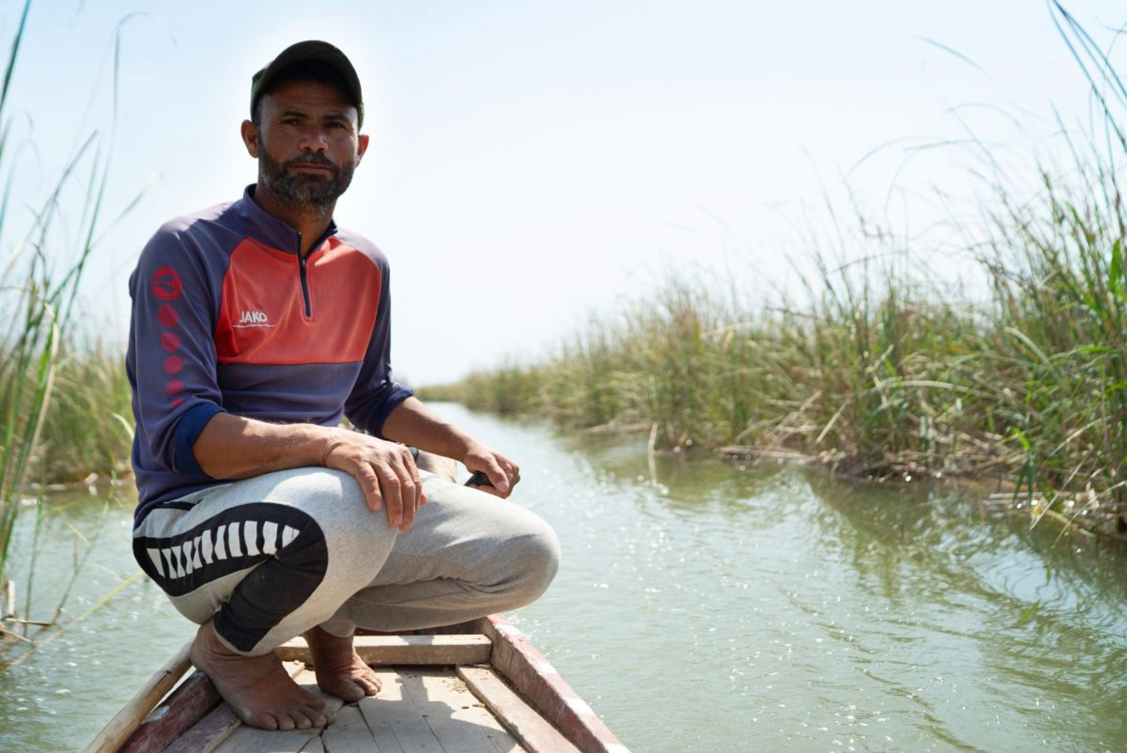 Razaq Nasser Saber steers his boat through reeds on the Mesopotamian Marshes