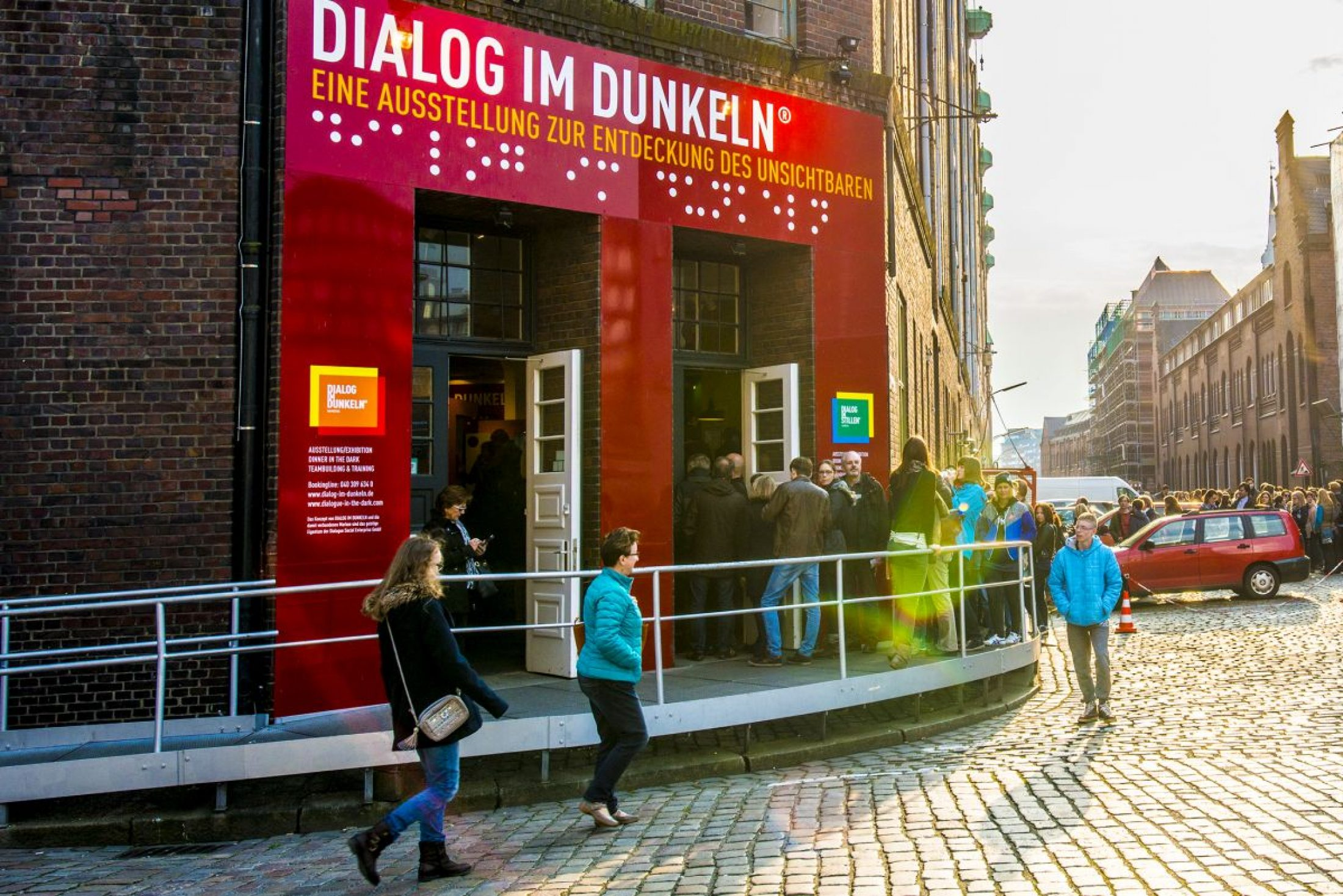 Queues stretch across the street for Hamburg's 'Dialogue in the Dark'