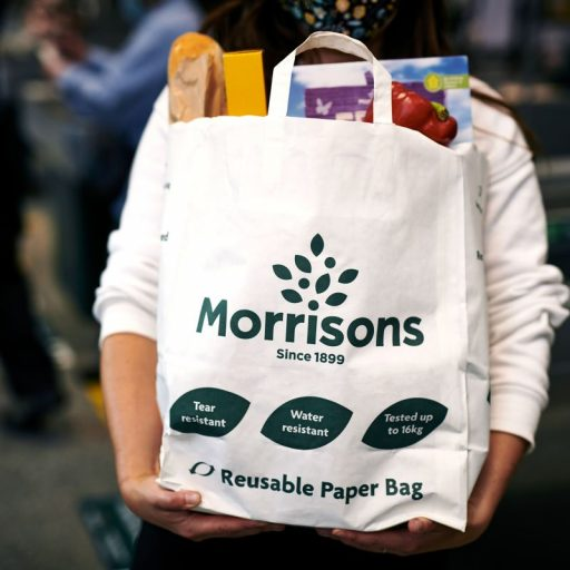 Morrisons is trialling paper carriers at select stores, with the intention of axing plastic carriers from all of its shops