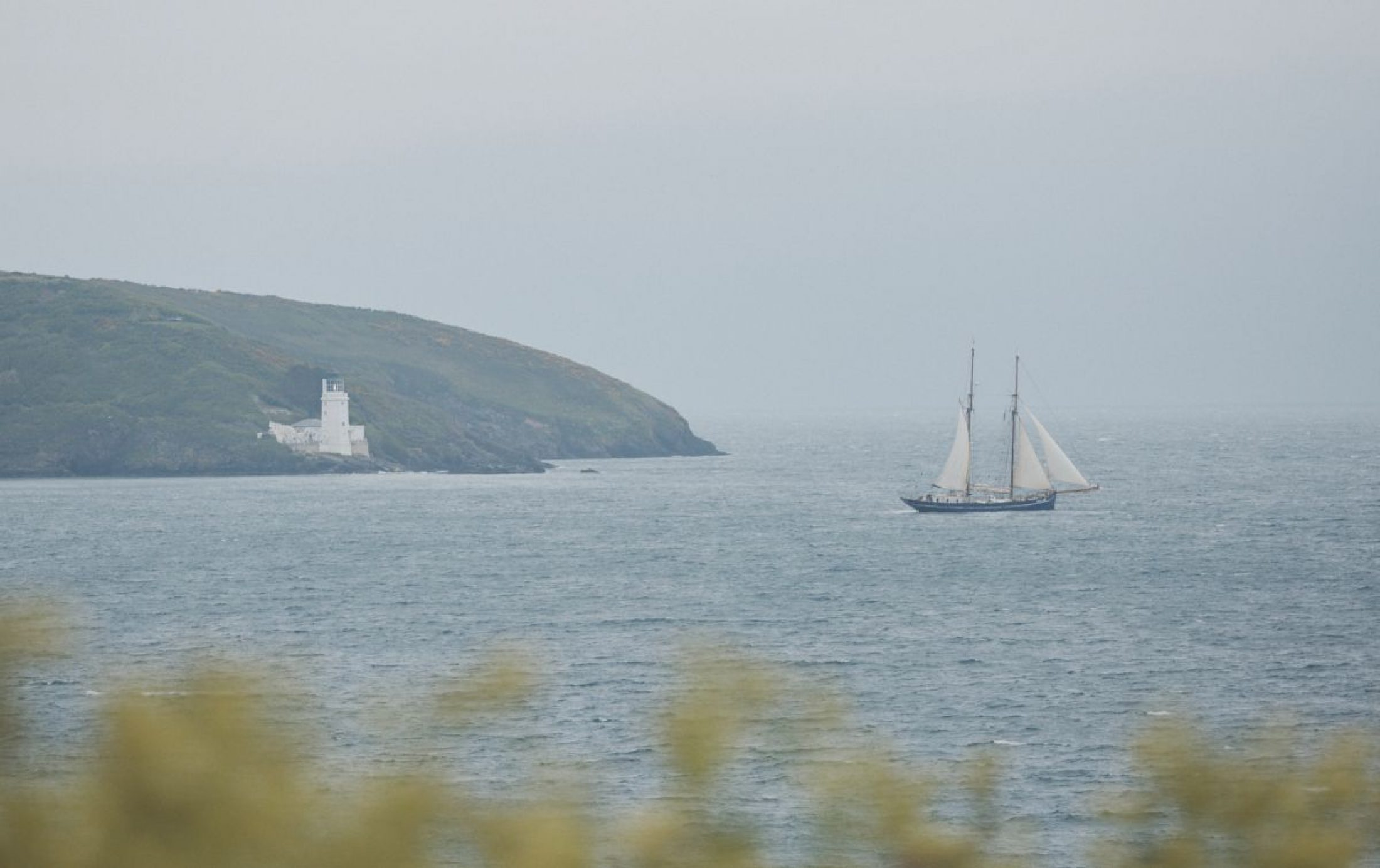 Pictured amid sea spray, De Gallant took three months to sail from Colombia to Cornwall