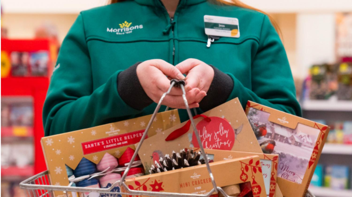 Supermarket clerk with Christmas products