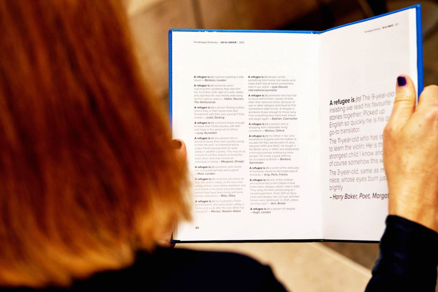A woman reading The Refugee Dictionary